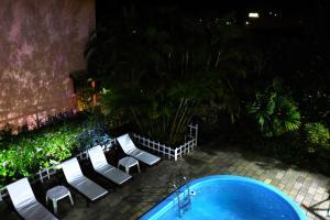 Uma vista da piscina em Pousada Beijos y Abraços ou nos arredores