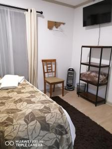 A bed or beds in a room at Casa Hotel Trocha Angosta