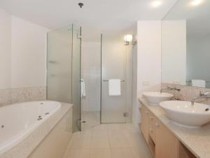 A bathroom at Sebel 808 by G1 Holidays