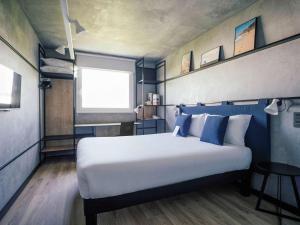 Cama o camas de una habitación en Ibis Barcelona Castelldefels