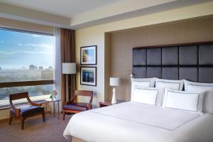 A bed or beds in a room at Swissôtel Al Ghurair Dubai