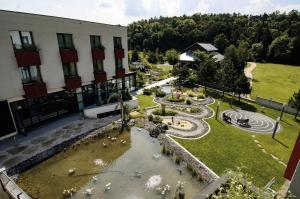 A view of the pool at Linsberg Asia Hotel, Spa & Therme - Adults Only or nearby