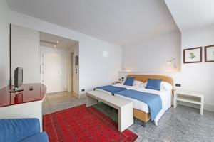 Кровать или кровати в номере Hotel Salò du Parc