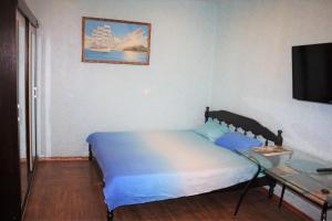 Кровать или кровати в номере 1 комнатная квартира Корпусная д26