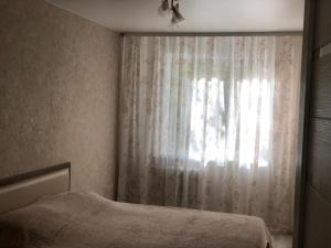 A bed or beds in a room at Апартаменты на Иванова