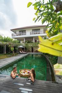 The swimming pool at or near Amatara Athaya Ubud