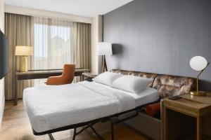 A bed or beds in a room at Residence Inn Austin Downtown / Convention Center