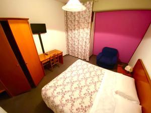 Letto o letti in una camera di Hotel Pamela