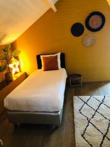 Een bed of bedden in een kamer bij Hotel Valkenhof