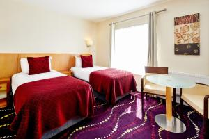 A bed or beds in a room at Arlington Hotel O'Connell Bridge