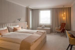 Ein Bett oder Betten in einem Zimmer der Unterkunft Kongress Hotel Davos