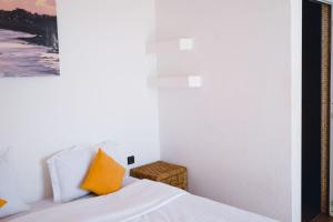 A bed or beds in a room at Surf Maroc's Auberge