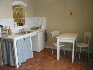 Kuchnia lub aneks kuchenny w obiekcie Fajne Miejsce