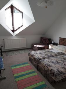 A bed or beds in a room at Panoráma Üdülőszálló