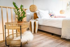 A bed or beds in a room at Just Texel Suites & Apartments