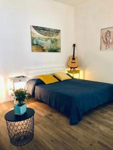 Un pat sau paturi într-o cameră la Chalet del Centro