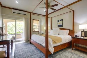 A bed or beds in a room at San Ignacio Resort Hotel