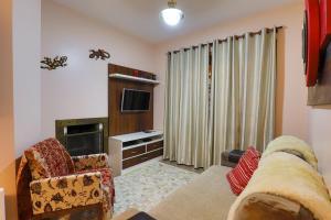 A seating area at Apartamento de 1 quarto