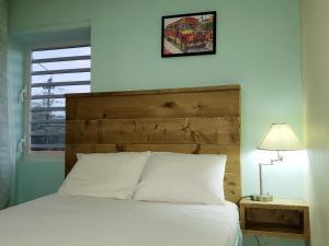 Cama ou camas em um quarto em Mustique Suites Curacao