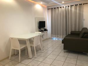 Una televisión o centro de entretenimiento en Apartamento/Flat em Aracaju