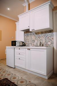 A kitchen or kitchenette at Marfuga Apart - Hotel