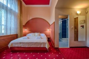 Postel nebo postele na pokoji v ubytování Hotel Zlatý Orel