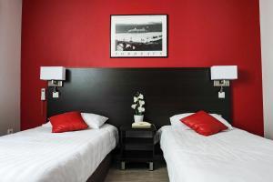 Un ou plusieurs lits dans un hébergement de l'établissement Hôtel Notre Dame