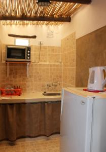 Una cocina o kitchenette en Huaira Huasi