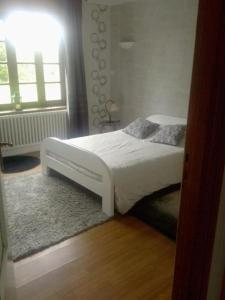 A bed or beds in a room at Apartment Concarneau