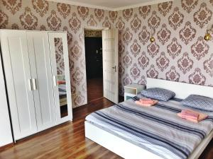 Кровать или кровати в номере Апартаменты на ул. Ленина 219/35