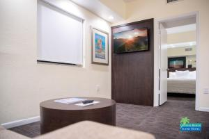 A television and/or entertainment center at Crystal Beach Suites Oceanfront Hotel