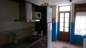 Una cocina o zona de cocina en Apartamentos Turisticos As Cetareas
