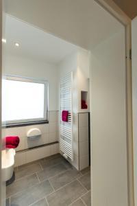Ein Badezimmer in der Unterkunft Pension L&N