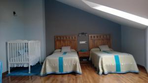 Cama o camas de una habitación en Apartamentos Turisticos As Cetareas