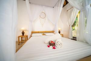 A bed or beds in a room at Green CoCo House