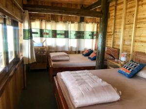 A bed or beds in a room at Po Mu House