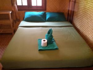 A bed or beds in a room at Phu View Guesthouse