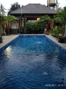 The swimming pool at or close to Turtle Garden Hotel