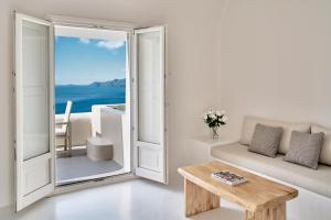 A seating area at Mystique, a Luxury Collection Hotel, Santorini