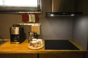 A kitchen or kitchenette at Vanilla Sky Boutique Hostel