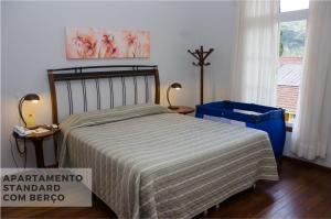 Cama ou camas em um quarto em Hotel Villa Michelon