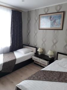"A bed or beds in a room at ""Престиж"""