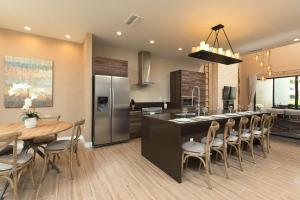 A kitchen or kitchenette at Magic Village Views Trademark Collection by Wyndham