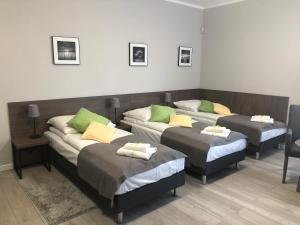 Łóżko lub łóżka w pokoju w obiekcie Villa Rosa