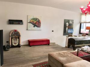 A television and/or entertainment center at Luxury torrearsa with SPA