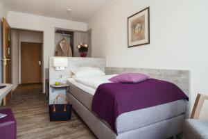 A bed or beds in a room at Sengelmannshof