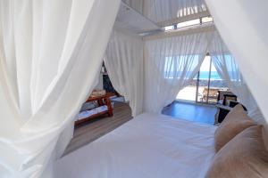 Cama o camas de una habitación en Hotel Puntagrande