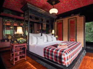 Кровать или кровати в номере Capella Ubud, Bali