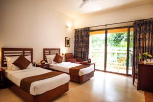 A bed or beds in a room at Abad Green Forest Thekkady
