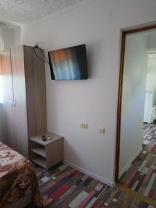 A television and/or entertainment center at Частный сектор Aquarelle
